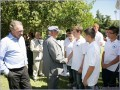 "Capt. Panagiotis N. Tsakos congratulates the young students of ""Maria's Home"". On the left, Mr. Nikos P. Tsakos and in the background Mr. Costas Karamanis from the Chios office of Tsakos Shipping."